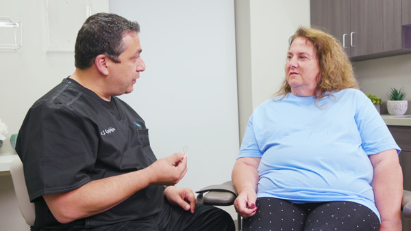 Dr. Krajekian discusses chin implant options with a patient during her initial consultation
